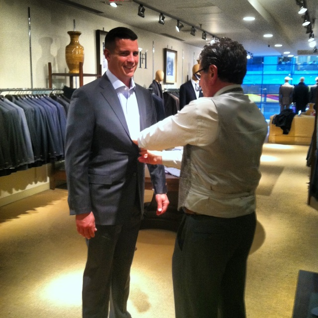 The winner, Steve, trying on suits in the Hickey Freeman store on Madison Avenue.